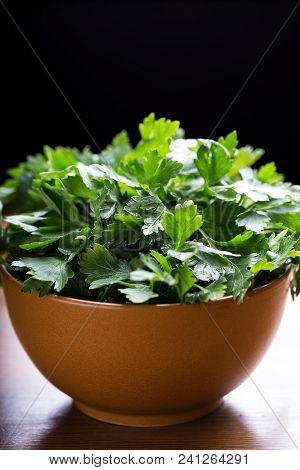 Green Parsley. Fresh Green Parsley On The Wooden Table