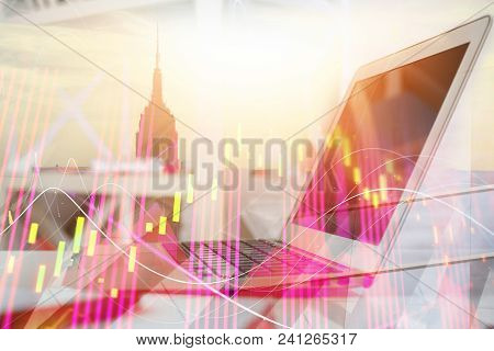 Side View Of Laptop With Forex Chart On Abstract City Background. Technology And Finance Concept. Do