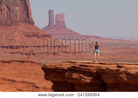 Girl At John Ford's Point. View On Merrick Butte And East Mitten Butte.