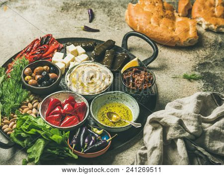 Mediterranean, Middle Eastern Meze Starter Platter. Stuffed Pickled Paprikas, Dolma, Hummus, Spiced
