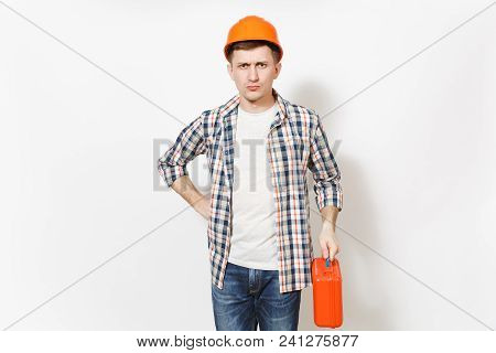 Young Concerned Man In Casual Clothes And Protective Hardhat Holding Case With Instruments Or Toolbo