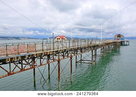 Victorian Pier At Mumbles In Swansea Bay