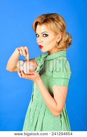 Beautiful Retro Woman Hold Piggy Bank, Moneybox For Savings. Pin Up Girl Putting Coin In Piggy Bank.