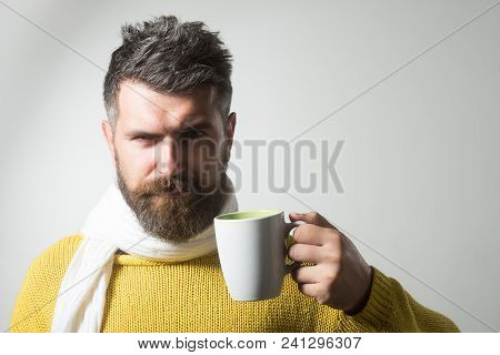 Handsome Man With Beard And Moustache Enjoying Coffee Or Tea. Serious Man Holding Cup With Hot Drink