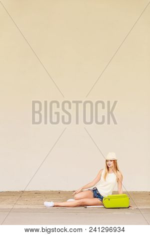 Travel, Adventure, Teenage Journey Concept. Woman Wearing Denim Shorts, White Top And Sun Hat Suitca