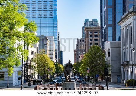 Raleigh, Nc - April 17, 2018: George Washington Statue And Downtown Raleigh, North Carolina On Fayet