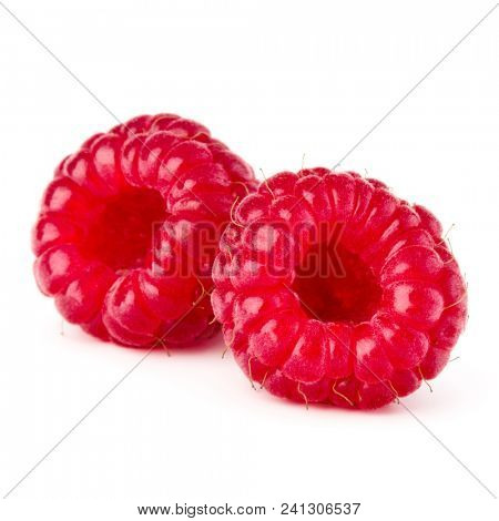 two ripe raspberries isolated on white background close up