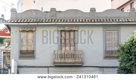Architecture Of Classical Building Facade On Old Historical House. Exterior Of White Color Apartment