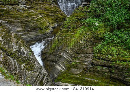 Water Falls In The Watkins Glen State Park In New York, Flowing Through The Rock Formations