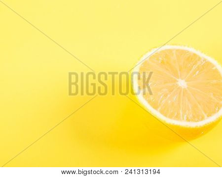 Half Of Lemon On A Yellow Background