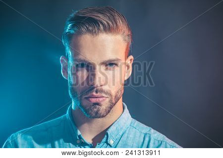 Emotions, Feelings, Facial Expressions Concept - Serious Fashionable Bearded Man. Sexy Handsome Man