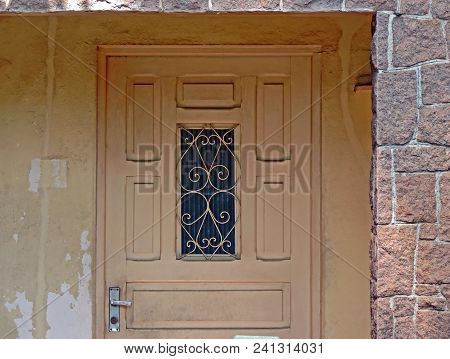 Detail Of The Entrance Door Of An Old House
