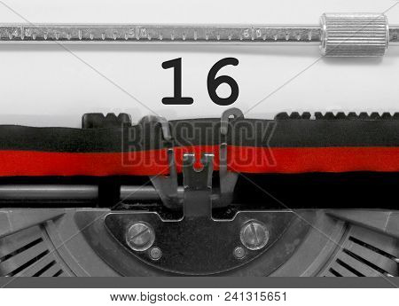 16 Number Text Written By An Old Typewriter On White Sheet