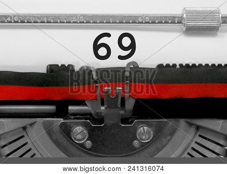 69 Number Text Written By An Old Typewriter On White Sheet
