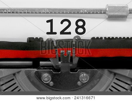 128 Number Text Written By An Old Typewriter On White Sheet