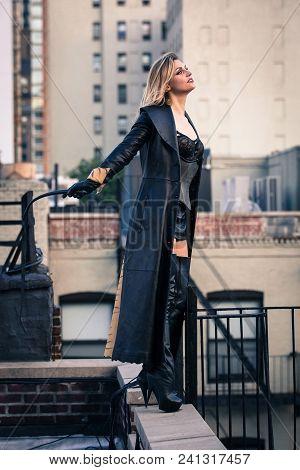 Beautiful Woman Dominatrix Mistress Posing On The Roof