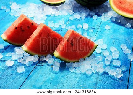 Watermelon On Blue Background. Juicy Summer Fruit In Slices