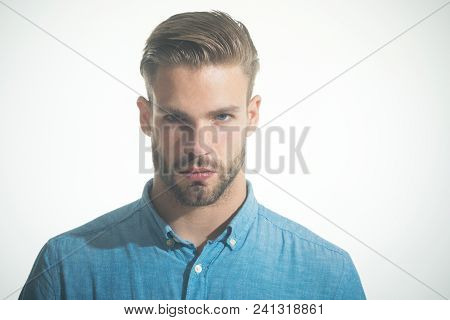 Attractive Bearded Man In Casual Clothing. Handsome Unshaven Man In Denim Shirt. Sexy Serious Fashio