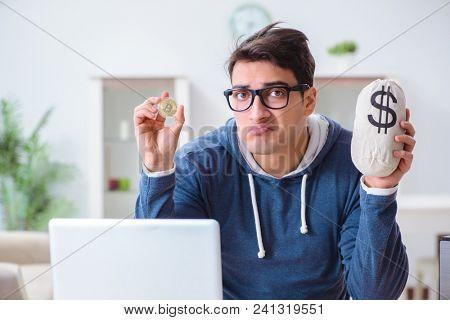 Young man mining bitcoins at home