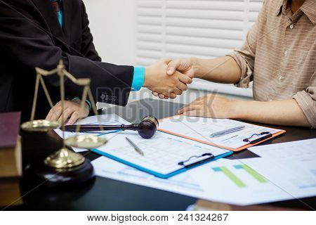 Businessman Shaking Hands To Seal A Deal With His Partner Lawyers Or Attorneys Discussing A Contract