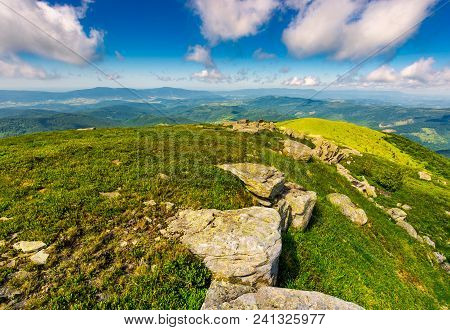 Mountainous Landscape In Summer. Lovely Scenery With Rocky Formation On The Grassy Hill Under The Bl