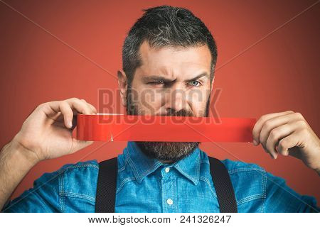 Businessman Silenced With Duct Tape Over His Mouth. Bearded Man With Wrapping Adhesive Tape Around M