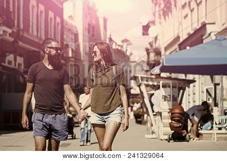 Couple Secrets Fantasy. Fashion, Urban Style, Lifestyle. Sexy Woman And Bearded Man Hold Hands On St