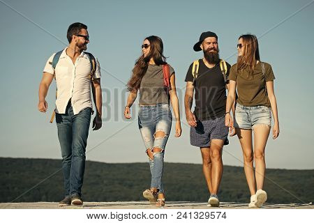 Wanderlust, Vacation, Travel, Hiking. Men And Women Travel On Summer Vacation. Happy Friends On Blue