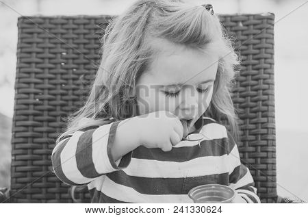 Child Childhood Children Happiness Concept. Food, Refreshing Dessert Eating Concept. Kid With Frozen
