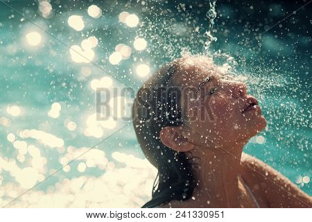Woman Face Beauty. Maldives Or Miami Beach Water. Beauty Of Woman Is Moisturized In Bath. Cute Woman