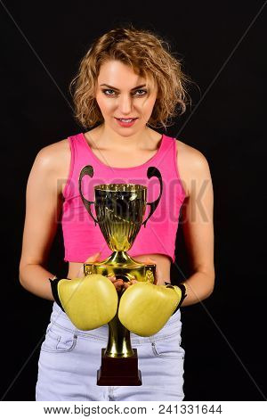 Victory, Winner And Success Concept - Beautiful Woman In Sportswear With Boxing Gloves Holding Gold