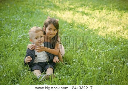 Happy Kid Having Fun. Family, Children, Brother And Sister On Green Grass. Family, Love Trust Concep