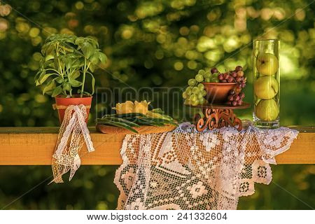 Still Life Of Fresh Fruit, Vegetables And Plant On Natural Background. Apples In Vase, Grapes, Peppe