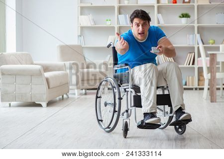 Disabled man watching sports on tv