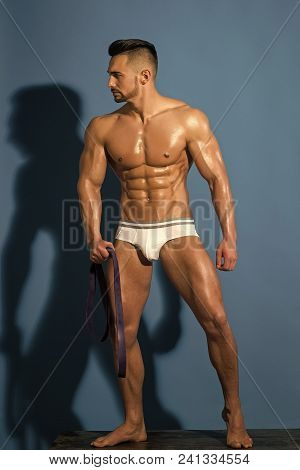 Man Isolated Full Body. Dieting And Fitness. Athletic Bodybuilder Man On Blue Background. Sport And