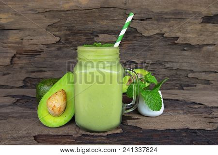 Avocado Juice Smoothies, A Tasty Healthy Drink In A Glass, Drink The Morning On A Wooden Background.