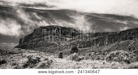 Black And White Desert Ridge Under A Cloudy Sky Landscape