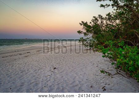 Sandy Ocean Beach At Sunset Background Abstract