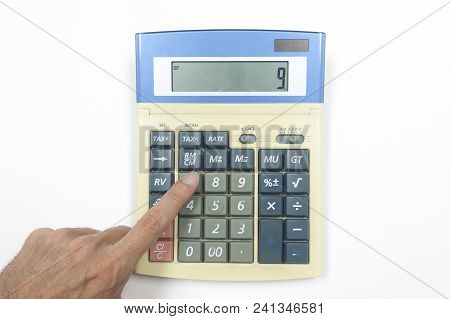 Top View Of Calculator On White Background.