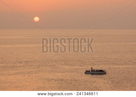 Yacht In The Tropical Sea At Sunset.