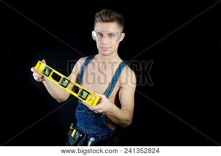 Handyman Shirtless. Sexy Guy And Level. Handsome Young Guy. Portrait. Handyman Shirtless. Smile And