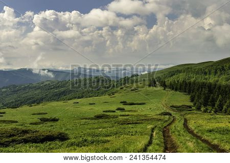Mountain Landscape View On A Valley From Mountain Peak. Sky And Mountain Natural Landscape. Nature L