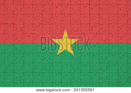 Burkina Faso Flag  Is Depicted On A Folded Puzzle