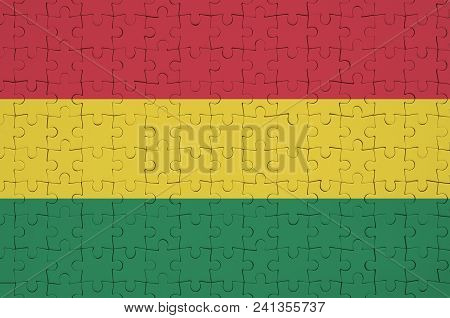 Bolivia Flag  Is Depicted On A Folded Puzzle