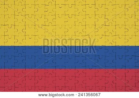 Colombia Flag  Is Depicted On A Folded Puzzle