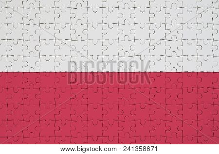 Poland Flag  Is Depicted On A Folded Puzzle
