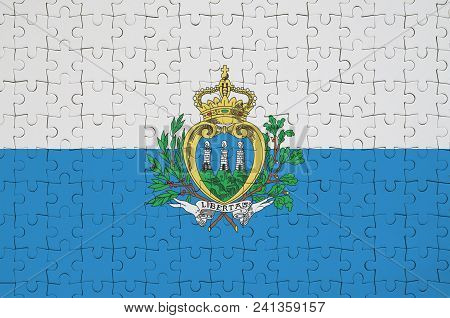 San Marino Flag  Is Depicted On A Folded Puzzle