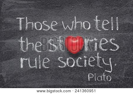 Who Tell Stories Famous Quote Of Ancient Greek Philosopher Plato Written On Chalkboard With Red Hear