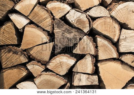 Abstract Photo Of A Pile Of Natural Wooden Logs Background, Top View Texture