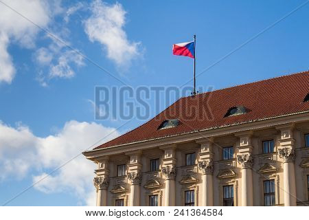 Czech Flag In The Wind On The Roof Of Ministry Of Foreign Affairs In Prague, Czech Republic. Blue Sk
